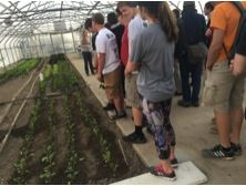 Students touring a greenhouse in Eden Hall