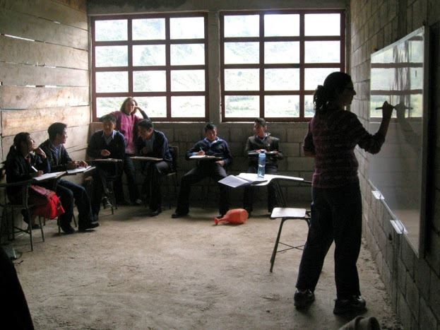 Dr. Oyanedel-Craver teaching at a local high school in San Mateo Ixtatan Guatemala